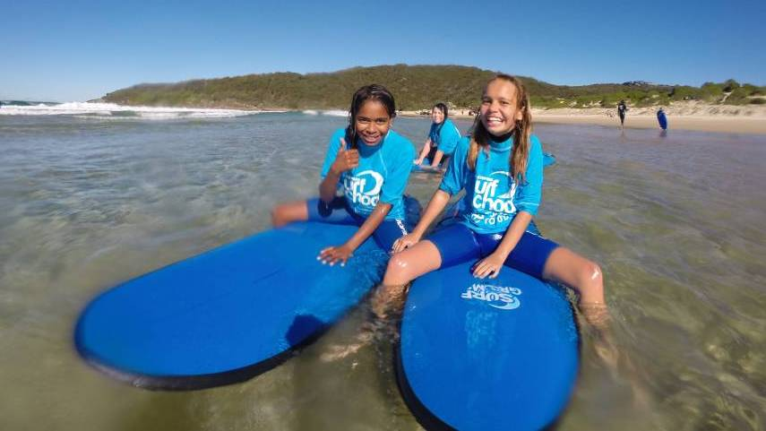 Children Get A Taste Of Surf And Sand For The First Time